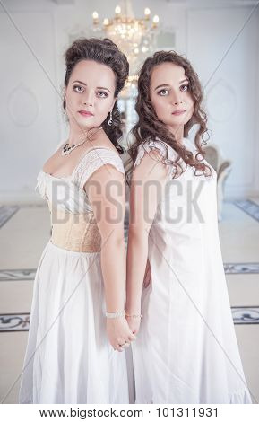 Two Beautiful Woman In Old-fashioned Negligee