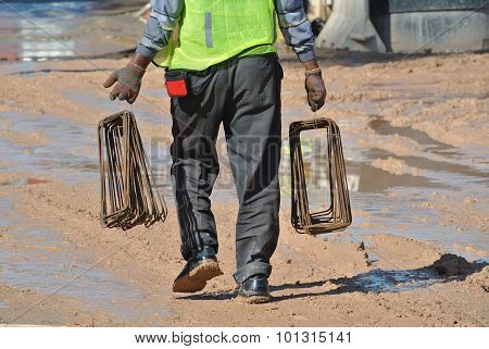 A construction workers walking in the construction site