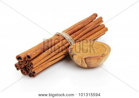 cinnamon sticks with powder, isolated on white