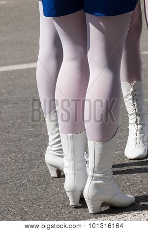 Woman's legs in white boots