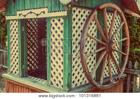Old Wooden Water Well House With A Large Wheel