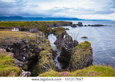 Travel to Iceland in the summer. Picturesque fancy fantastic coastal cliffs Arnastapi