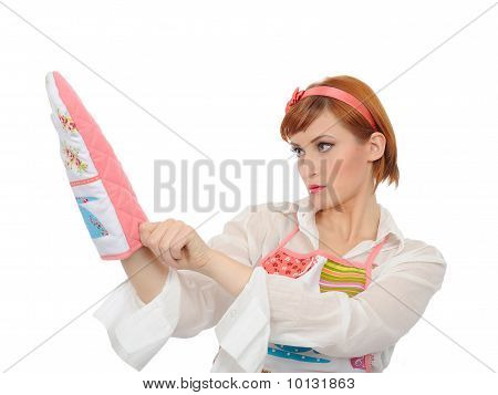 Beautiful Cooking Woman In Apron Putting On A Kitchen Glove. Isolated On White Background