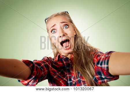 Close Up Portrait Of A Young Shocked Blonde Girl Holding A Smart