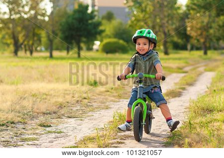 The child riding a bicycle
