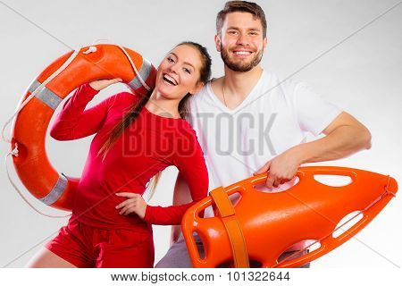 Lifeguard Couple With Rescue Equipment