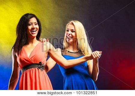Two Funny Women Holding Hands In Dresses.