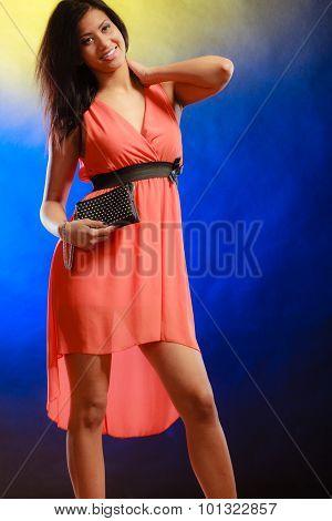 Elegant Woman In Dress Holds Handbag