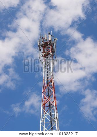 Telecom tower in  cloudy blue sky