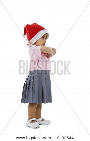 Süßes Mädchen mit Nikolausmütze