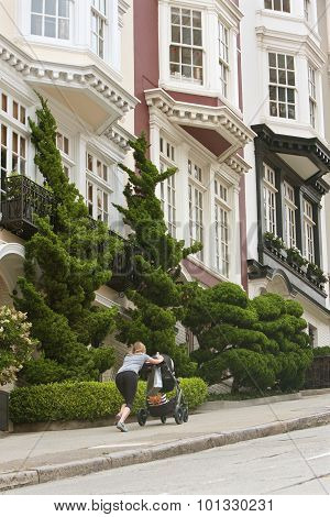 Woman Pushes Stroller Up Steep Incline In Nob Hill Area