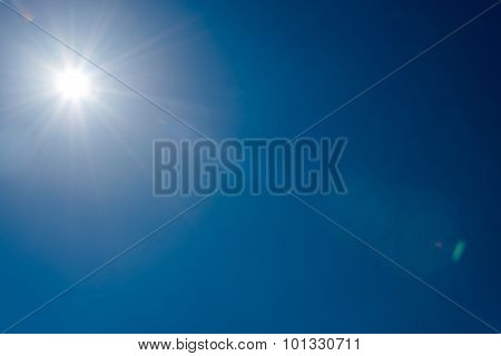 Sun And Flare  In Clear Blue Sky Without Clouds