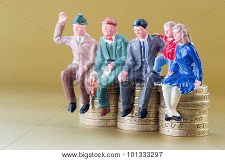 Model Family Sits On British Pound Coins