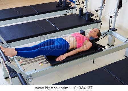 Pilates reformer woman foot work exercise workout at gym indoor