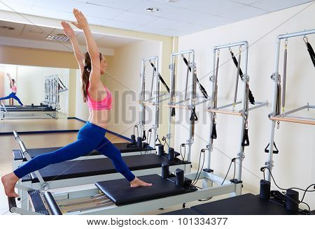 Pilates reformer woman russian split exercise workout at gym indoor