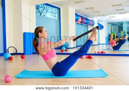 Pilates woman teaser magic ring exercise workout at gym indoor