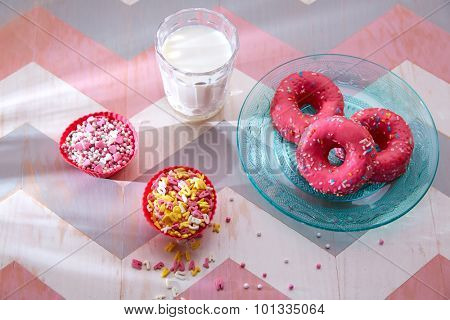 Kids party with milk pink donas and cupcake toppings as breakfast