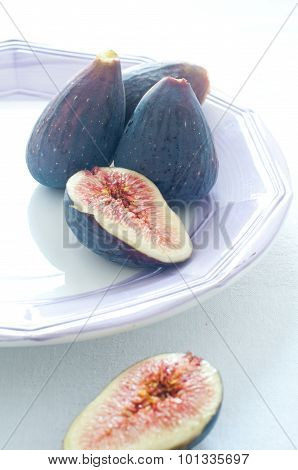 Group Of Colored Figs On The Colorful Background