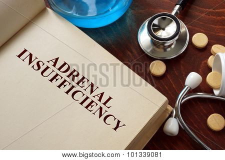 Adrenal insufficiency written on book with tablets.