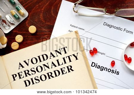 avoidant personality disorder written on book with tablets.