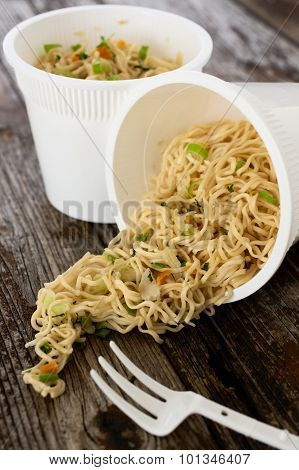 Instant Noodles Pasta Ramen Spilled On Rustic Wood Table
