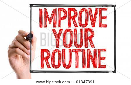 Hand with marker writing the word Improve Your Routine