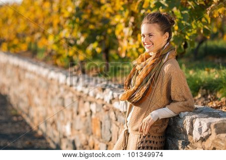 Portrait Of Relaxed Elegant Woman In Autumn Outdoors
