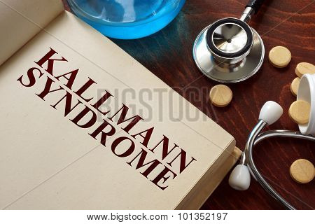 Kallmann syndrome written on book with tablets.