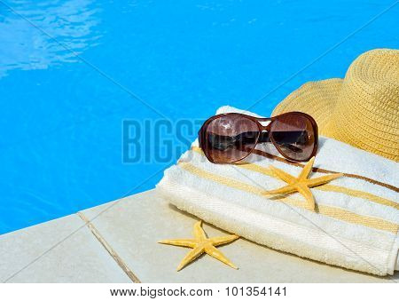 Beach Hat, Sunglasses, Bath Towel, Starfish Near The Swimming Pool