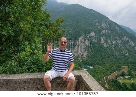 Man Is Posing On Canyon Of Tara River Background, Montenegro.