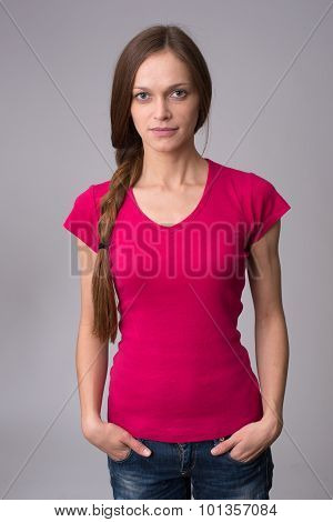 Beautiful Girl With Pigtails On Gray Background