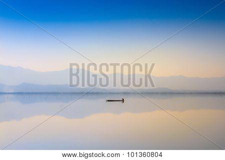 Calmness Lake In Sunset