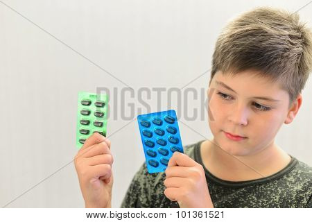 Boy In Camouflage Shirt Holding A Drugs