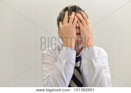 Depressed Teenager Boy Covered His Face With His Hands