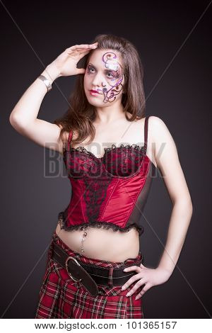 Face Art Concept: Portrait Of Caucasian Female With Unique Face Art Painting. Posing In Corset Again