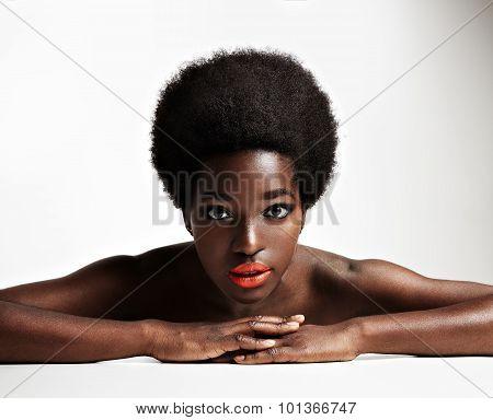 Black Woman Lying Down And Watching At Camera
