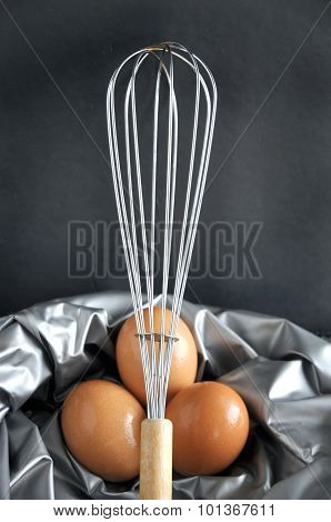 Close Up Whisk In Front Of Eggs