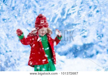 Little Girl Playing In Snow