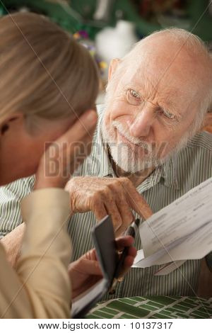 Senior Couple With Many Bills