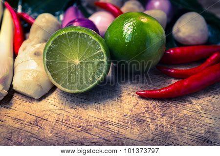 Close Up Kaffir Lime Leaf, Lemon, Lemongrass, Galangal, Chili, Onions And Straw Mushroom On Chopping
