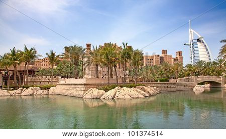 DUBAI, UAE - APRIL 18: View of the hotel Burj Al Arab from Souk Madinat Jumeirah. April 18, 2014 in Dubai. Madinat Jumeirah is luxury hotel, entertainment anf shopping center on Jumeirah beach.