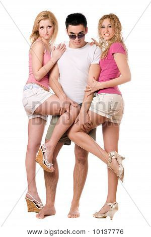 Young Man And Two Playful Girls