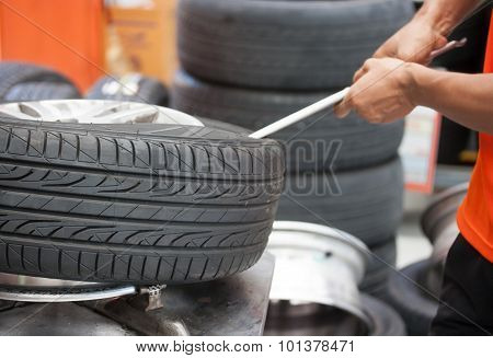Mechanic Changing Car Tire Closeup