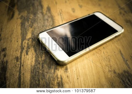 Smart Phone With Blank Screen Lying On Table