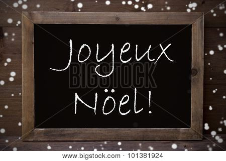 Chalkboard With Joyeux Noel Means Merry Christmas, Snowflakes