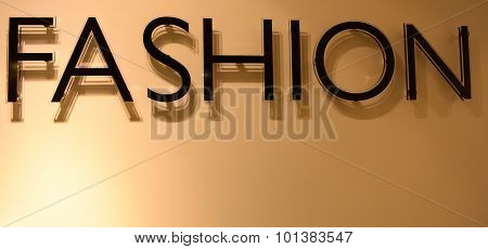 Black Text Fashion Casting Shadow On Gloden Background