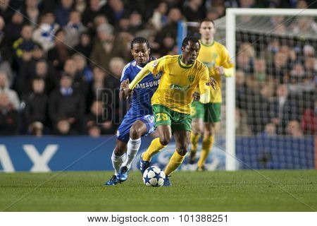 LONDON ENGLAND 23 NOVEMBER 2010.Chelsea's midfielder Florent Malouda and MSK Zilina's forward Bello  in action during the UEFA Champions League match between Chelsea FC and MSK Zilina