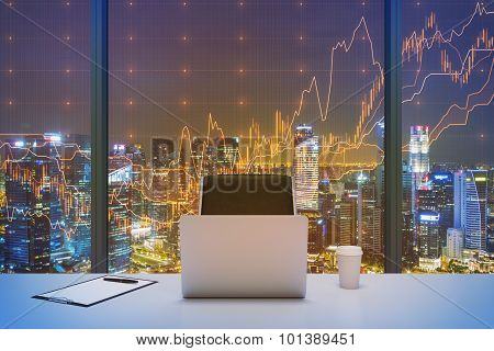 A Workplace In A Modern Panoramic Office With New York Evening View And Financial Chart Over The Win