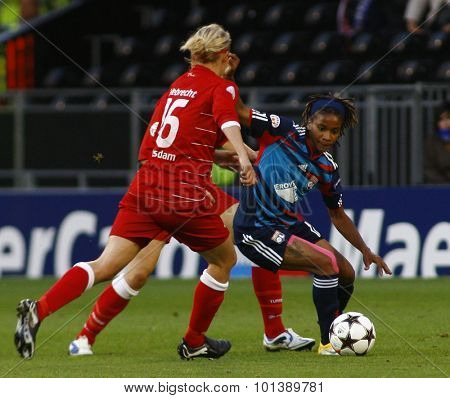 LONDON, ENGLAND. 26 MAY 2011 Potsdam's  Viola Odebrecht and Lyon's forward Elodie Thomis during the 2011 UEFA Women's Champions League final between FFC Turbine Potsdam and Olympique Lyonaise