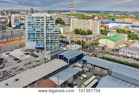 Aerial view of office building and urban quarters